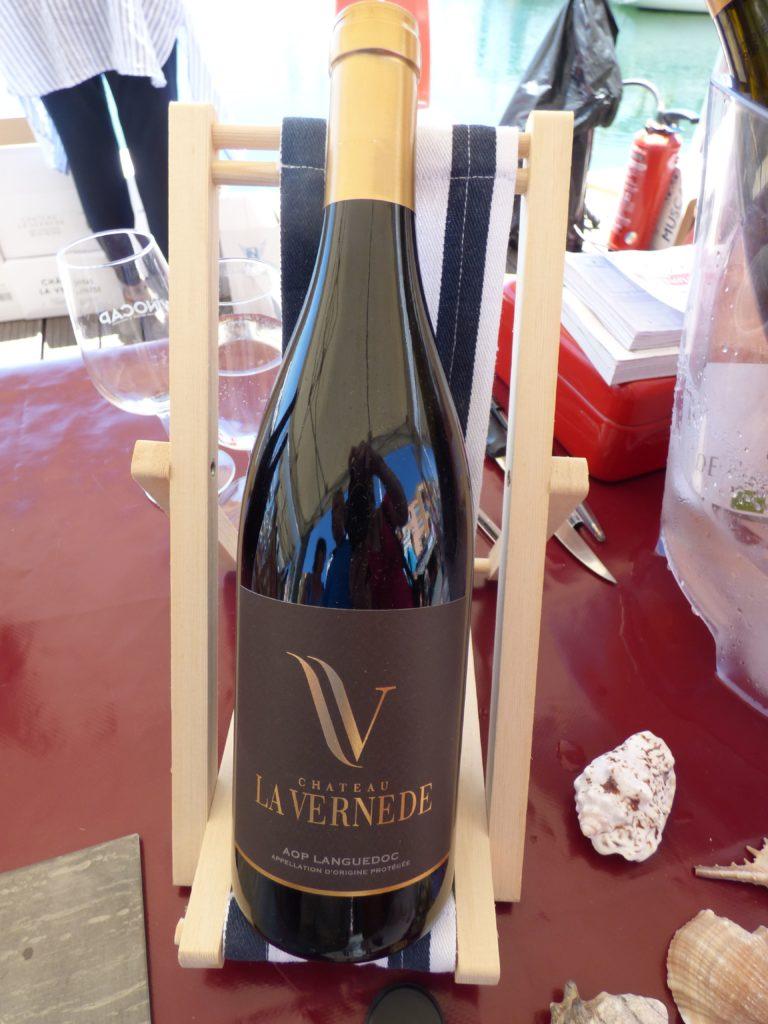 Bouteille de vin rouge Château la Vernède, du domaine la Négly, présentée au Vinocap 2019